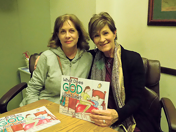 "KENTON BROOKS/Muskogee Phoenix<br /> Louise Bishop, left, and Pam Bradley combined their talents for a faith-based children's book, ""What Does God Look Like?"" Both women are from Muskogee, but Bradley lives in Broken Arrow. The two will sign the book at 11 a.m. to 2 p.m. Saturday at Hattie's House Antiques in downtown Muskogee."