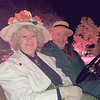 Jonita Mullins (dressed as first Oklahoman Congresswoman Alice Robertson) and Larry Ross brought out a classic car to participate in the Muskogee Christmas Parade Friday night.