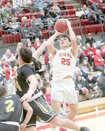 JOHN HASLER/Special to the Phoenix<br /> Fort Gibson's Tegan Thornbrugh hits a step-back jumper over the Jay defense on Friday. The Tigers won 66-52.