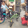 "CHESLEY OXENDINE/Muskogee Phoenix<br /> Ta'niyah Dixon (left) and Alvaro Perez (right) got a Christmas surprise Thursday when Morgan Towing brought them bicycles. The delivery was part of a program called ""Hooked On Pedaling"" started by Morgan Towing drivers' manager Kevin Fausett. Fausett used donations from local businesses to purchase 50 bikes – 25 for boys and 25 for girls – and deliver them to children of low-income families. ""I like my decorations,"" Ta'niyah said of her gift. ""I'm still learning how to ride a bike."""