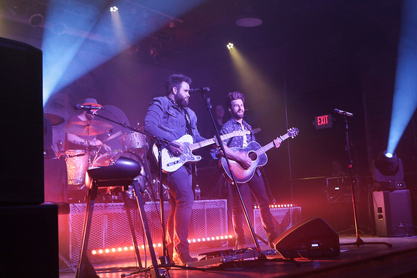 Special photo by Mandy Lynn Lundy<br /> Zach Swon, standing, left, join Colton Swon for a rousing concert Friday, benefiting Muskogee Salvation Army. Bright lights and enthusiasm filled Oklahoma Music Hall of Fame.