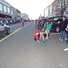 KENTON BROOKS/Muskogee Phoenix<br /> Kids scramble to pick up candy on Broadway thrown from floats, cars and trucks during Saturday's Muskogee Christmas Parade. The parade was originally scheduled for Dec. 8, but the threat of icy weather postponed it.