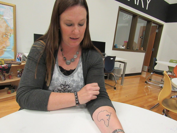 CATHY SPAULDING/Muskogee Phoenix<br /> Amanda Cumbey shows a map of Africa tattooed on her forearm. The heart designates Kenya, where Cumbey went on two mission trips.