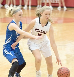 ABIGAIL WASHINGTON/Special to the Phoenix Hilldale's Kaylee Sanders dribbles ball around a Claremore Sequoyah defender during Friday's game at Hilldale Event Center. The Lady Hornets won 50.40.