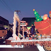 KENTON BROOKS/Muskogee Phoenix<br /> The Grinch rides by in a float during the Muskogee Christmas Parade on Saturday.