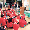 WENDY BURTON/Special to the Phoenix<br /> Muskogee Public Schools Superintendent Jarod Mendenhall talks with children at the annual Santa Claus Breakfast on Saturday.