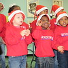 Staff photo by Cathy Spaulding<br /> Dream Team choir singers including Gunner King, left, and Ken'Terrian Mangrum, second left, sing at the Santa Claus Breakfast, held Saturday at Muskogee High School cafeteria. This is the 38th year for the  breakfast.