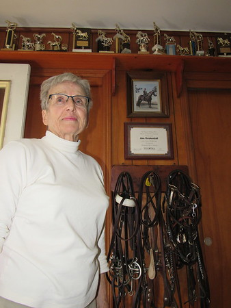 Staff photo by Cathy Spaulding<br /> Ann Kuykendall keeps years of trophies and tack in her garage. She used to breed and show Tennessee Walking Horses.