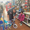 Special photo by Chesley Oxendine<br /> Sgt. Drew Branan, Summer Grishom, Officer Shane Leech, and Kaylee Tilly work their way down a toy aisle in Wal-Mart during Saturday's shopping event.