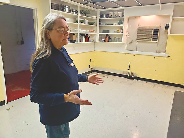 CHESLEY OXENDINE/Muskogee Phoenix<br /> Adventist Community Services Director Judy Reid stands in the kitchen of newly opened offices and discusses renovations potentially coming to the room.
