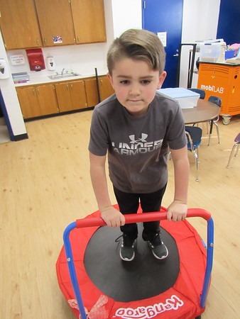 CATHY SPAULDING/Muskogee Phoenix<br /> Hilldale Elementary first-grader Tristan Nau demonstrates a small trampoline that will be in a sensory room. The school received a $23,500 grant for more equipment for the room.