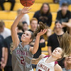 Phoenix special photo by Von Castor<br /> Sequoyah's Alexys Keys scores in front of Lincoln Christian's Addie Brooks on Monday at Lincoln Christian. The Class 3A No. 1 Lady Indians defeated the Lady Bulldogs 56-29.