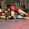Phoenix special photo by John Hasler<br /> Fort Gibson's Tyler Fuller throws down Pryor's Bronner Bressette during Monday's dual meet at Fort Gibson High School.