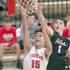 VON CASTOR/Special to the Phoenix<br /> Hilldale's Ty O'Neal, right, blocks the layup attempt of Fort Gibson's Jaiden Graves during Tuesday's game at Harrison Field House in Fort Gibson. The Hornets beat the Tigers for the first time since 2010, 60-58.