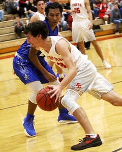 Phoenix special photo by John Hasler Fort Gibson's Chance Wafford drives for score during Friday's game at Harrison Field House. The Hornets won 68-28.