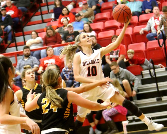 Phoenix special photo by John Hasler<br /> Hilldale's Lacey Bell gets by the Jay defense for a layup during Friday's game at the Hilldale Event Center. The Lady Hornets won 64-59.