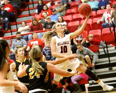 Phoenix special photo by John Hasler Hilldale's Lacey Bell gets by the Jay defense for a layup during Friday's game at the Hilldale Event Center. The Lady Hornets won 64-59.