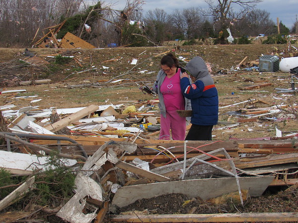 CATHY SPAULDING/Muskogee Phoenix<br /> Sherry Murphy and her son, David Murphy, look for valuables or mementoes in the building debris at Sue's Recycling and Sanitation, which was destroyed by a Friday night tornado. Sherry Murphy said her husband works for the recycling center.