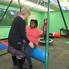 Staff photo by Cathy Spaulding<br /> Ben Franklin STEM Academy teacher Carol Ford helps student Niasia Jones settle on a swinging seat in the school's Sensory Room. The room features items that help stimulate or calm students enough to help them focus in class.