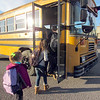 CATHY SPAULDING/Muskogee Phoenix<br /> Okay Elementary students get on the bus Thursday afternoon, the last day of Okay's school week. Okay maintains a four-day school week.