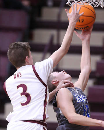 VON CASTOR/Phoehnix Special Photo<br /> Haskell's Bradley Ward is fouled in the lane by Warner's Camden Chappell in action Thursday night at the Warner Event Center.