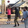 CATHY SPAULDING/Muskogee Phoenix<br /> Demontae Nails, center, defends against an attempted shot by Darius Jackson while Jefr'e Nelson gets into position to rebound during a pickup basketball game Thursday at Spaulding Park. Sunny skies and a light, cool breeze prompted people to enjoy the outdoors.