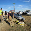 "Staff photo by Cathy Spaulding<br /> Muskogee Fire Department personnel put yellow tape around a manhole after it was struck Thursday morning by a Honda Accord. The Accord had struck a Volvo station wagon. <br /> Muskogee Police Officer Matt Perryman said the northbound Volvo station wagon driven by Sandra Hill was crossing into the J & E parking lot, 1509 N. Main St., when it was struck by a 1996 Honda Accord. Perryman said the Accord driver left the scene. J & E owner Ed Johnson said the driver of the Honda ""came highballing down Main, 60 miles an hour."" He said the<br /> Honda bounced two feet after hitting a manhole that extended from a ditch. ""Then he runs up here cussing a blue streak,"" Johnson said about the Honda driver, adding that the driver ran away. Johnson said Hill did not complain about any injuries from the accident."