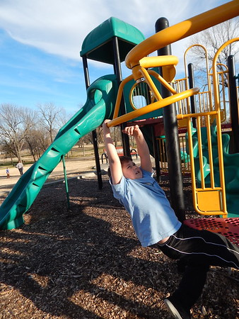 """KENTON BROOKS/Muskogee Phoenix<br /> With sunny but cool weather outside, Franklin Lipe, 6, checks out the various playground equipment at Robison Park on Friday. Katherine Lunk, Lipe's aunt, accompanied him to the park because """"it was a nice day and we wanted to get out of the house."""" Lipe, a first-grader at Grant Foreman Elementary School, was also getting ready for the arrival of Santa Claus."""