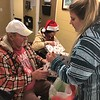 CHESLEY OXENDINE/Muskogee Phoenix<br /> William Smith receives some help from staff member Brandy Lovett with opening a gift.