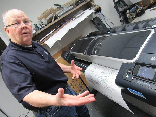 CATHY SPAULDING/Muskogee Phoenix<br /> William Goodwin explains how a plotting machine can print and cut a blueprint in less than one minute, one of many technological changes Goodwin has seen over 46 years as a draftsman.