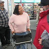 Staff photo by Cathy Spaulding<br /> Clerk Mesha Ashley visits with Jack Byrd, right, one of her regular  customers at CVS Pharmacy. Ashley's father, the Rev. Clarence Ashley, looks on.