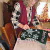 Staff photo by Cathy Spaulding<br /> Janet Bowen shakes glitter off a stocking she is making. Bowen has sold crafts at area shows.