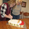 Staff photo by Cathy Spaulding<br /> Janet Bowen decorates a Santa-shaped cupcake confection while her birth mother, Jennie Lee Bounds Calderwood, watches. Bowen and Calderwood share a knack for baking and decorating.