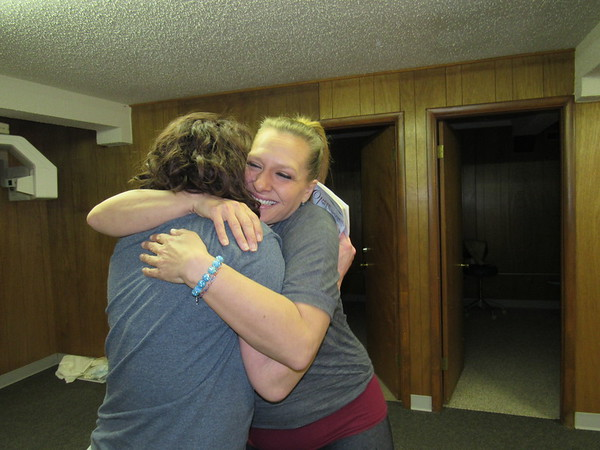 Staff photo by Cathy Spaulding<br /> Rani Paxton, right, embraces Sarah Thompson. Paxton couldn't stop smiling after she received her new dentures Saturday.