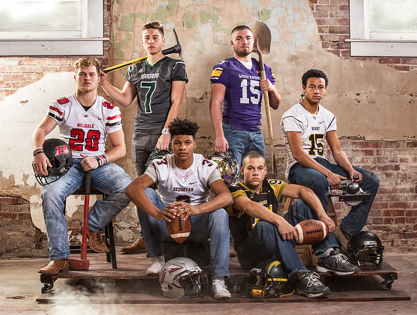 Special photo by Mandy Lundy<br /> All-Phoenix MVP Bobby Cade (second from left, seated) is surrounded by, clockwise from left, Large School Defensive Player of the Year Brock Owensby of Hilldale, Large School Offensive Player of the Year Jacob Medrano of Muskogee, Small School Defensive Player of the Year River Simon of Vian, Small School Offensive Player of Year Jacob Bruce of Hulbert and Newcomer of the Year Leslie Howard of Midway.