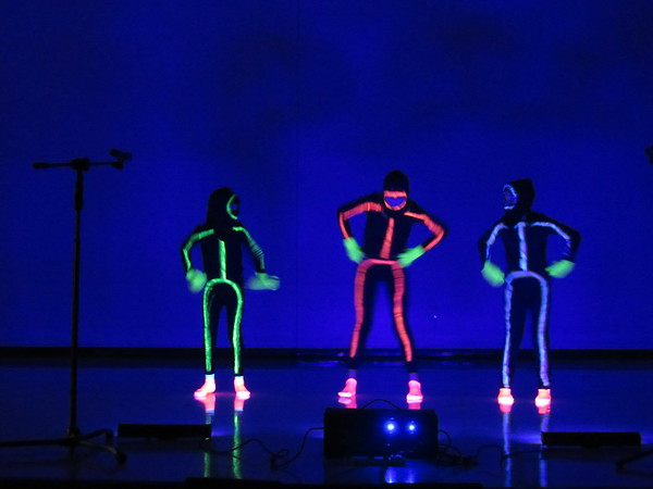 CATHY SPAULDING/Muskogee Phoenix<br /> Dancers, from left, Klaire Bracken, Jessica Hardy and Ella Wheeler look like glow in the dark stick figures in their Dance Mix at the Intermediate Elementary Variety Show.