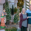 "SHANE KEETER/Special to the Phoenix<br /> Davey and Donna Johnston stand in front of their house on Georgia Avenue holding a $100 bill, first prize in the annual Muskogee Phoenix ""Deck the House Holiday Lights Contest."""