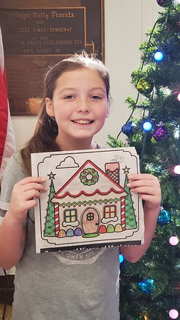 CHESLEY OXENDINE/Muskogee Phoenix<br /> Ciara Ballard displays her winning entry into the Muskogee Phoenix Christmas Coloring Contest. Ballard won a 6-foot-tall stocking full of goodies — which she'll be sharing with her brother and sister, who also entered the contest (Tenasi Ballard, Ciara's sister, won third place.)