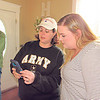 Red Dirt Military Moms co-founder Eva Turner, left, shares information with Shannon Hogan while delivering presents to Hogan's two sons. The boys' father, Sgt. Ryan Hogan, was killed at Fort Bliss in November.