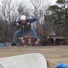 Staff photo by Cathy Spaulding<br /> Sean Tiffie of Tulsa catches air after riding a scooter up a skatepark slope.