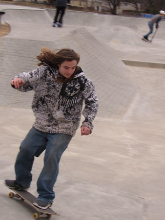 Staff photo by Cathy Spaulding<br /> Ryan Steward lets his hair fly while skateboarding around Midland Valley Skatepark on Tuesday. Chilly weather couldn't keep people from trying their skateboards and scooters out at the Robison Park  skatepark. According to the AccuWeather website, low temperatures are expected to dip into the low 20s this week, though daytime weather should be above freezing