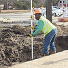 CATHY SPAULDING/Muskogee Phoenix<br /> A worker with H&G Paving Contractors measures the depth of a hole dug Thursday under 24th Street north of Okmulgee Avenue. Work has begun on 24th Street between Okmulgee Avenue and Martin Luther King Street, the first phase of a 24th Street improvement project. Muskogee Public Works Director Greg Riley said 24th Street is being replaced between Okmulgee Avenue and Shawnee Bypass. A water line under the street also will be replaced. A sidewalk will be added along the street. Riley said the entire project is contracted for 400 days.