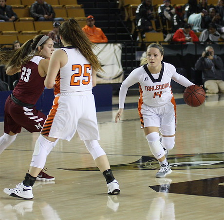 Phoenix special photo by Von Castor<br /> Tahlequah's Delaney Nix, right, drives past screen of Sierra L. Smith on way to score for the Lady Tigers against Muldrow in first-round action at the Tournament of Champions on Wednesday.