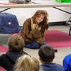 Staff photo by Mike Elswick<br /> Emma Terrill, 10, plays the role of a bear during a program on hibernation and migration.