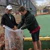 CATHY SPAULDING/Muskogee Phoenix<br /> Dry leaves had blown across the Spaulding Park tennis court over the past few days. Muskogee High School tennis team members Kyran English, left, and Josh Garner clear leaves from courts on Thursday afternoon.