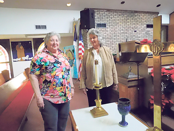 Elder Beverley Bighorse, left, and Glenda Drake of First Presbyterian Church of Wagoner pause as they walk through the sanctuary for one of the last times.