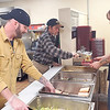 CHESLEY OXENDINE/Muskogee Phoenix<br /> From left, Brandon Torbett and Bobby King serve lunch to Jonathan Oliver at the Gospel Rescue Mission on Saturday afternoon.