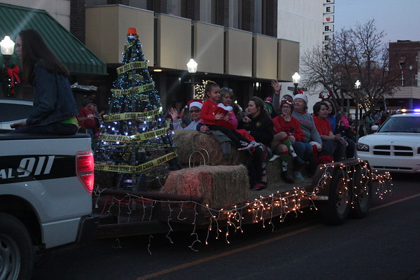 Special photo by Chesley Oxendine<br /> The Muskogee Sheriff's Department brought a Christmas tree draped in crime scene tape along with their float.