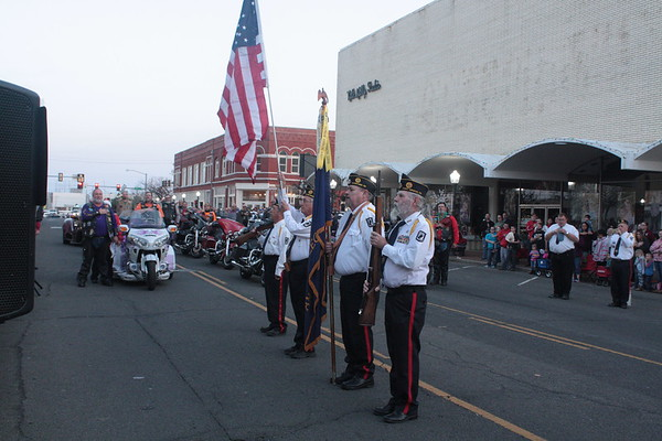 Special photo by Chesley Oxendine The American Legion Honor Guard presents the colors ahead of Saturday night's Christmas parade.