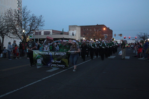 Special photo by Chesley Oxendine<br /> Northeastern State University's marching band made a showing during Saturday night's Christmas parade.